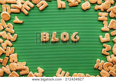 Word BLOG made from cookies on green corrugated background