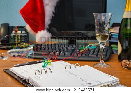 A desk after the Office Christmas party, focus on the diary entry.