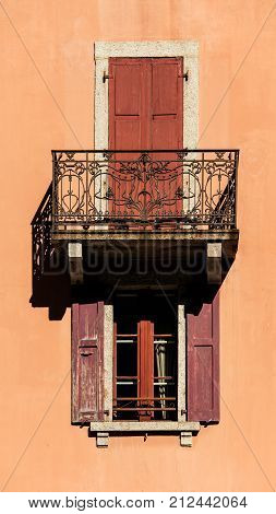 Classic French Apartment Exterior Shuttered Balcony And Windows