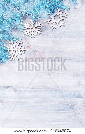 New Year and Christmas background. Christmas snowflakes blue fir tree branches on the wooden background. New Year and Christmas still life flat lay free space. Festive New Year still life. New Year composition. New Year background