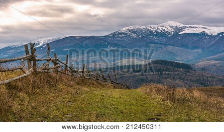 Wooden Fence On Hills Of Mountainous Countryside