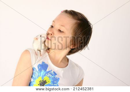 Cropped shot of cute little girl and her pet. Little girl and rat. Child and animal. Children, Pets, Childhood concept - close-up portrait of cute little girl with her pet rat.