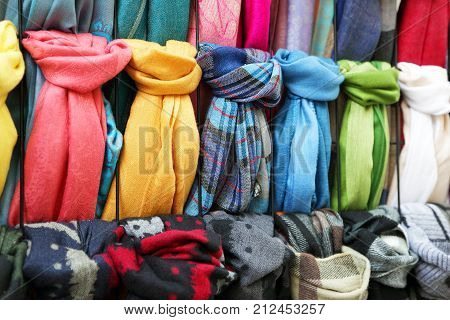 many multi colored scarves in the store