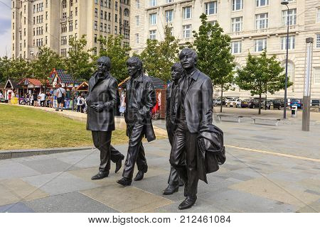 LIVERPOOL, UK - AUGUST 18: Bronze statue of the four Liverpool Beatles stands on Liverpool Waterfront by sculpture Andrew Edwards.  August 18, 2016 in Liverpool.