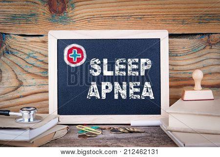 sleep apnea. Health Care. Chalkboard on a wooden background.