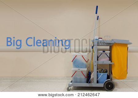 Big Cleaning word concept Cleaning Cart in the hospital with wall background.
