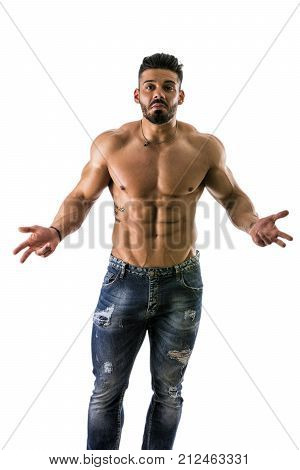 Muscular shirtless man unsure or confused, shrugging and opening his arms, isolated on white background in studio