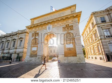 MONTPELLIER, FRANCE - July 28, 2017: View on the Foch boulevard with Triumphal arch and woman walking in Montpellier city during the morning light in southern France