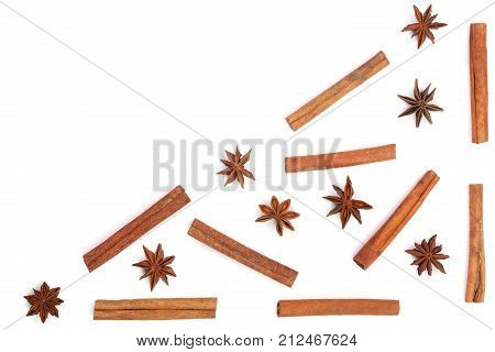 Composition of star anise and cinnamon sticks isolated on white background with copy space for your text. Abstract pattern flat lay, top view.