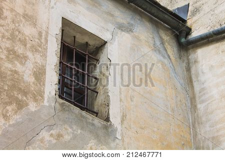 Old escape window with bars see from bottom