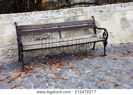 wooden bench for rest on paving stones