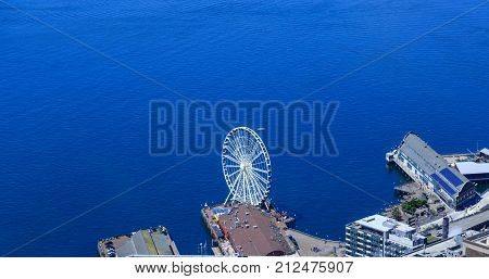 Aquarium and Ferris Wheel in Seattle by Puget Sound