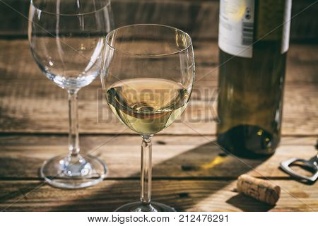 White Wine Glass On Wooden Background