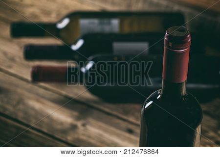 Red Wine Bottle On Wooden Background