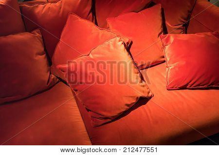 Red Velvet Square Pillows On Red Velvet Sofa For Abstract Background.