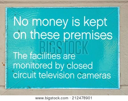 Warning sign stating that no money is kept on the premises