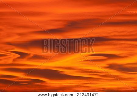 Beautiful sunset sky with lenticular clouds.Useful as a background.