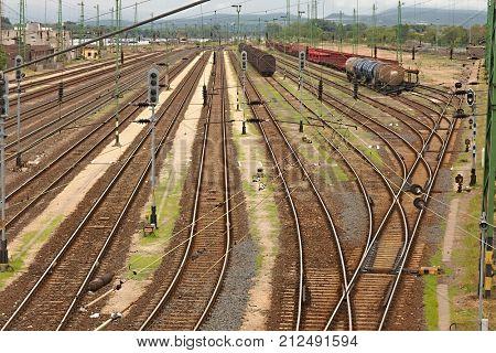 Many railway tracks at a station