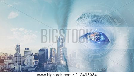 Double exposure, businessman's eye, with futuristic globe and technology graphic. Business vision concept. Elements of this image are furnished by NASA