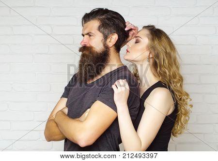 Couple In Love Hug On White Brick Wall