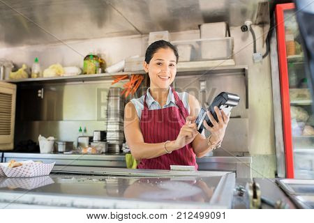 Food Truck Owner With Credit Card Terminal