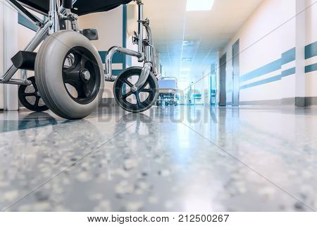 Empty Wheelchair Parked in Hospital Long Hallway