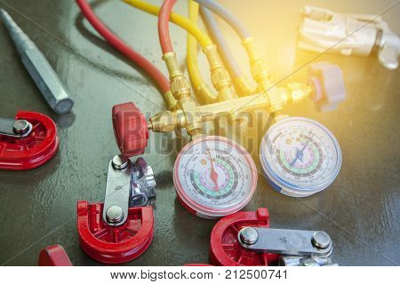 Air Conditioning Technician. manometers measuring equipment for filling air conditionersgauges.Tools for HVAC