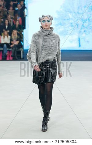 ZAGREB, CROATIA - OCTOBER 28, 2017: Fashion model wearing clothes from the Fall/Winter collection designed by Marina Design at the 'Fashion.hr' fashion show