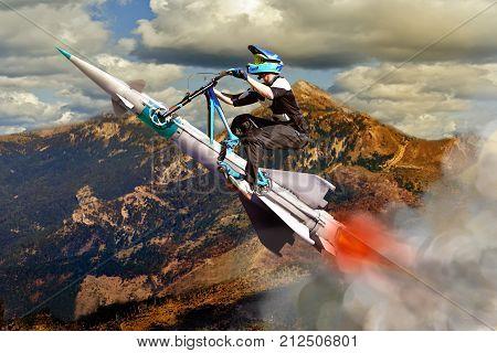 Conceptual image of biker, flying up upwards on a rocket
