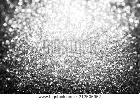 Black silver glitter sparkle background. Black friday shiny pattern with sequins. Christmas glamour luxury pattern, black christmas and glitter diamond background. Dark silver black friday pattern