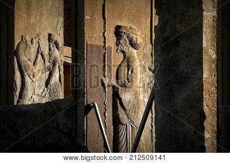 Persepolis is the capital of the ancient Achaemenid kingdom. Sight of Iran. Ancient Persia. Bas-relief carved on the old walls.
