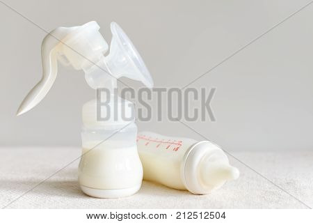 Breast Pump And Bottle With Milk For Baby