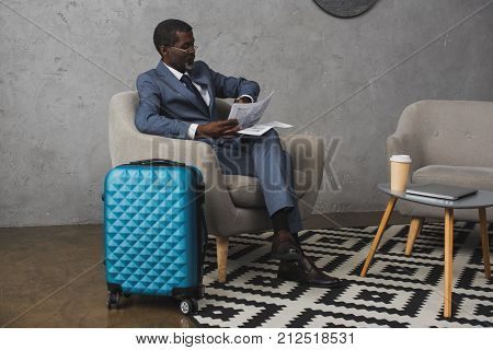 Businessman Checking Time On Watch