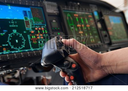 Close Up Pilot Holding Joystick In Helicopter Cockpit