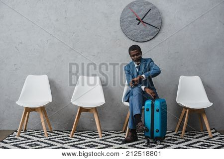 Businessman Sitting In Waiting Room