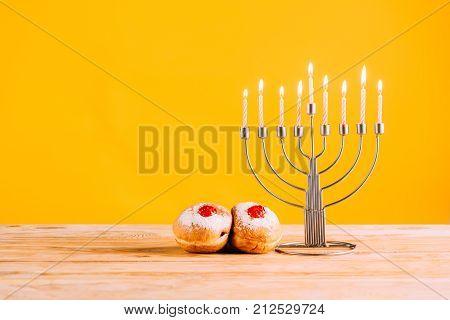 Hanukkah Celebrating With Menorah And Donuts
