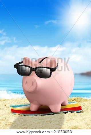 Piggy bank on beach money for travel concept