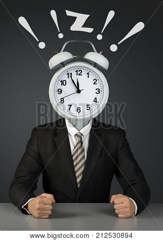 Businessman with clock instead of head time limit concept