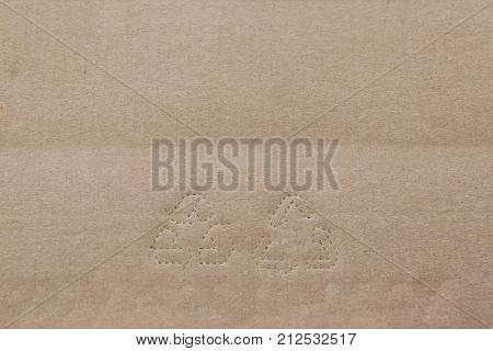 Stamp Recycling signs on recycling Natural color paper. Brown cardboard with horisontal strips