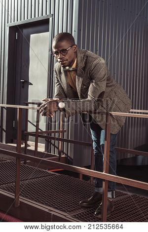 Handsome African American Man Leaning On Guardrails