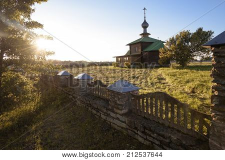 autumn landscape with a view of the Church in the beautiful weather on the background of bright blue sky
