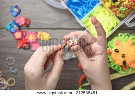 Children's Hands Closeup Weaving Crafts From Colored Rubbers, Education And Entertainment