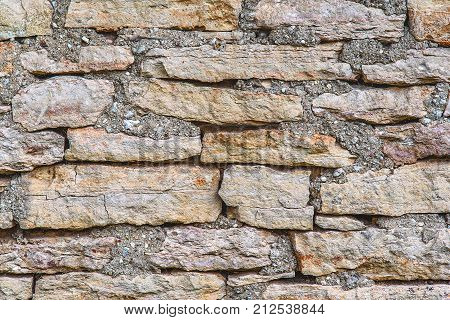 Horizontal shot of texture of a stone wall old stones background close-up