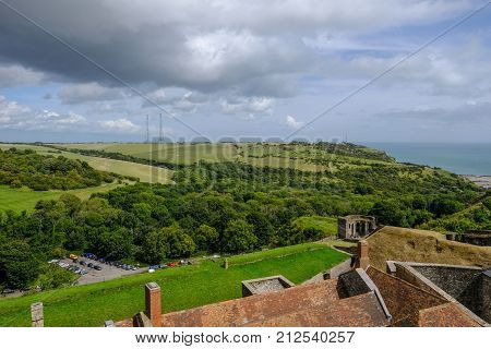 Aerial view from Dover Castle wall looking over countryside. Summer shot with glimpse of sea.
