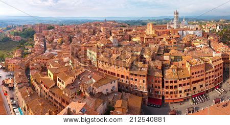 Beautiful aerial panoramic view of Siena Cathedral, Duomo di Siena, and Old Town of medieval city of Siena in the sunny autumn day, Tuscany, Italy