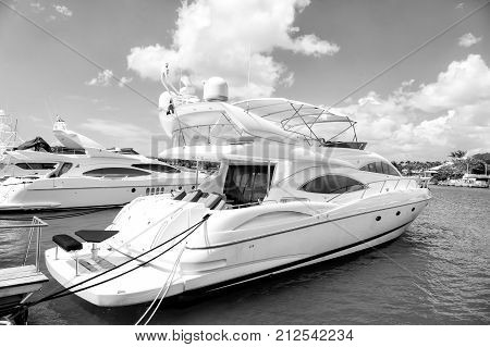 luxury yachts docked in the port in bay at sunny day with clouds on blue sky in La Romana Dominican Republic