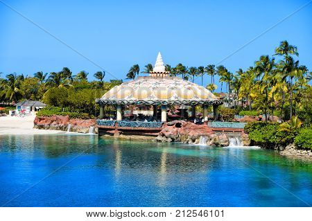 Lagoon bar open air terrace under aquatic dome ceiling in Nassau Bahamas. Architecture structure design. Summer vacation lounge recreation concept Hotel atlantis