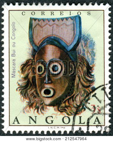 ANGOLA - CIRCA 1976: A stamp printed in Angola shows the Bui ou Congolo mask circa 1976