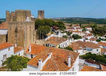 Rooftops of town and Castle. Obidos. Portugal