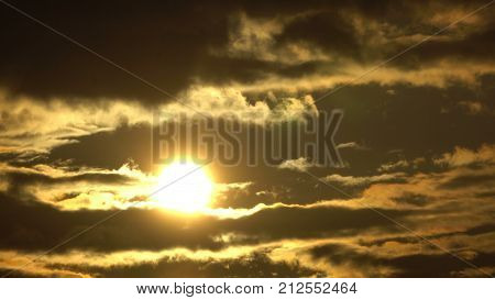 TIME LAPSE SUNSET, Brilliant summit dawn above flowing cloud waves, red sun disk time lapse in HDR, Close-up bright sun on the clouds time-lapse.